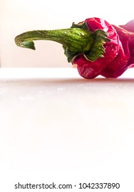 Hot pepper on white surface