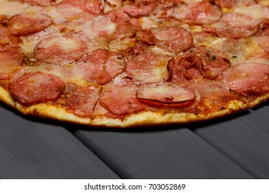 Hot pepperoni pizza on a wooden table