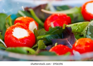 Hot peppers filled with feta cheese, and green salad
