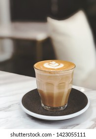 Hot piccolo latte in minimalist cafe vibes. Coffee concept. Selective focus, blurred background.