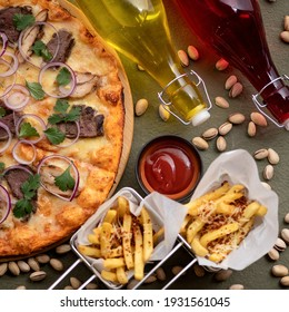 Hot Pizza, ketchup and fried, high angle view. Traditional italian food on table background. Nutrition dinner or lunch. 1x1 format.