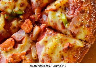 Hot pizza slice with  bell pepper vegetables delicious tasty fast food italian traditional on wooden board table classic,select focus.