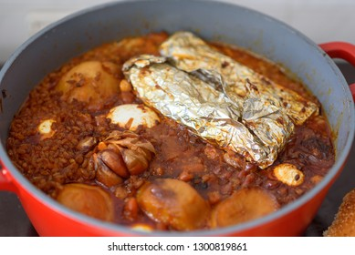 Hot plate for the Sabbath, a pot of spicy meat cooked with potatoes, barleys, jachnun,garlic,wheat and eggs. Pot of cholent Hamin in hebrew, top view. Traditional food Jewish Shabbat.