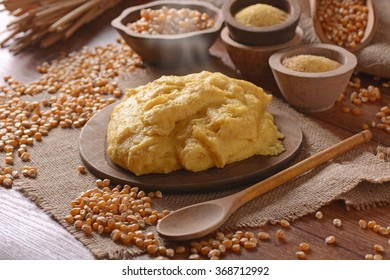 hot polenta in cutting board - traditional Italian recipe