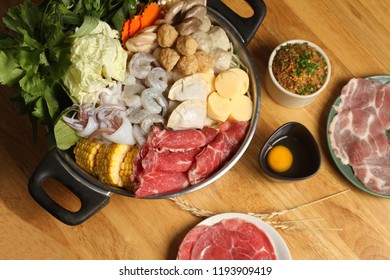 Hot pot on table background.