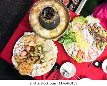 Hot pot or steamboat Asian style with meat, seafood, vegetable noodle served on charcoal powered pot