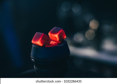 hot red coals with hookah in bowl for Shisha Smoking and traditional Asian relaxation close up