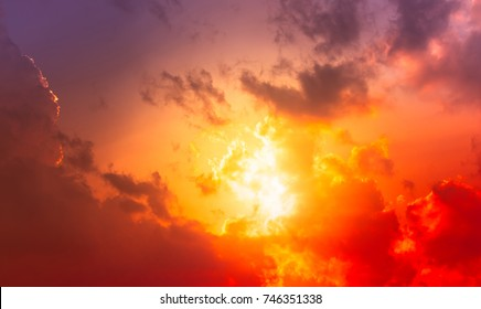 Hot red sunset light in orange and red color sky with clouds