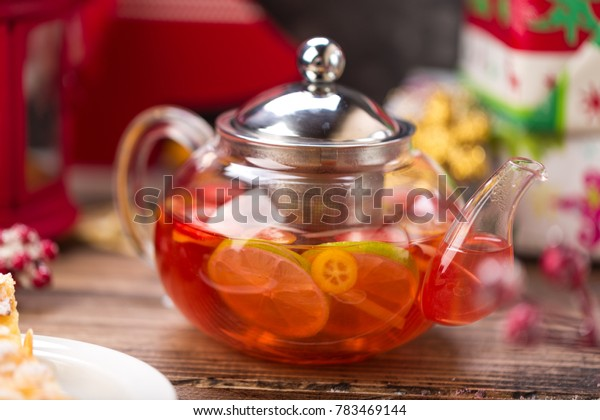 hot red tea in glass teapot Christmas decoration