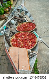 Hot red thai chillies drying outside in a boat