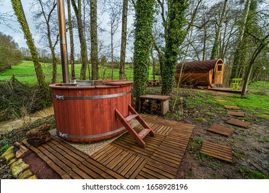 Hot and relaxing wooden bath in green and peaceful French countryside