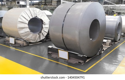 Hot rolled steel sheet in coil straps with steel strapping in warehouse storage, Plate metal sheet industry