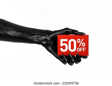 Hot sale topic: black hand holding a red card with a 50% discount on white background