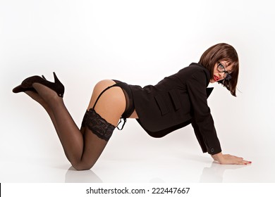 Hot secretary with sexy black lingerie and suit jacket in doggiestyle position.