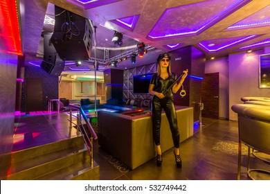 Hot sexy dancer in police uniform at a nightclub