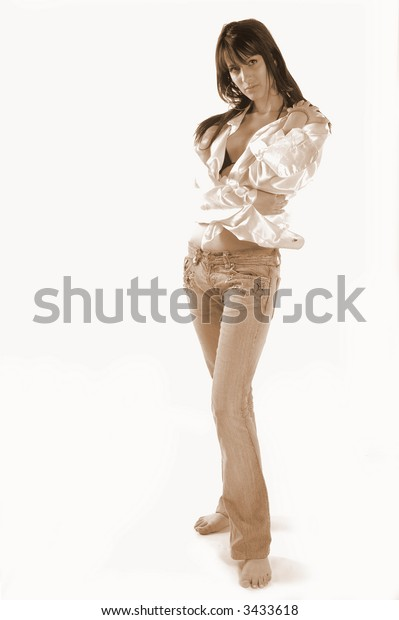 Hot sexy fit brunette with lots of hair in sepia color