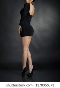 Hot sexy woman in black mini dress at sudio
