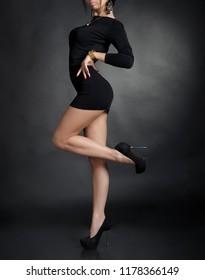 Hot sexy woman in black mini dress at sudio