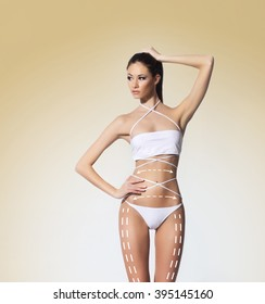 Hot and sexy woman in swimsuit. Plastic surgery concept.