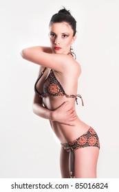 Hot sexy woman wear bikini , standing and showing body shape