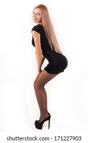 Hot and sexy young model in a black dress