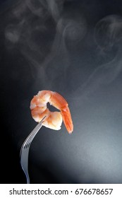 Hot shrimp on a fork with background space