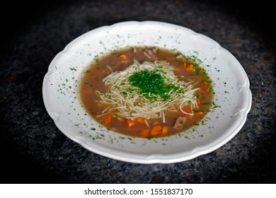 a hot soup with venison meat and vermicelli and carrot