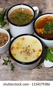 hot soups in mugs, vertical top view