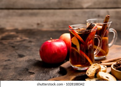 hot spicy beverage. Hot drink (apple tea, punch) with cinnamon stick and star anise. Seasonal mulled drink.