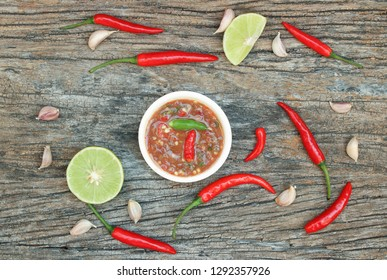 Hot and spicy food , Nam Prik Kapi in white bowl (Spicy shrimp paste sauce) and ingredient on wood background. Top view.
