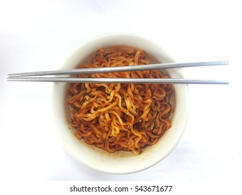 Hot and Spicy Korean Samyang ramen noodles in white bowl isolated on white background