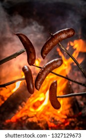 Hot and spicy sausage roasted on the bonfire
