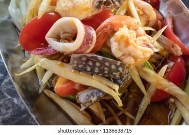 hot and spicy seafood papaya salad