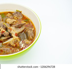 Hot and spicy soup with pig offal in a bowl on white background and copy space