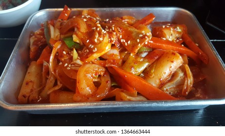 Hot and spicy tteokbokki noodles with red  chilli in stainless steel plate, Korean food.