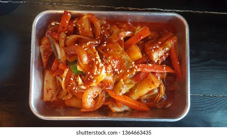 Hot and spicy tteokbokki rice cake with red  chilli in stainless steel plate, Korean food.