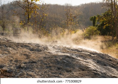 hot spring in Pai/hot spring in Mae Hong Son province in Northern Thailand/ Muang Paeng Hot Spring in Pai district /hot spring with the smell of hydrogen sulfide, mountain landscape on background