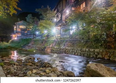 Hot spring towns, Kurokawa Onsen, Ryokan and bridge at night with lighting flare, Kurokawa, Kumamoto, Kyushu, Japan