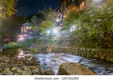 Hot spring towns, Kurokawa Onsen, Ryokan and bridge at night with lighting flare, Kurokawa, Kumamoto, Kyushu, Japan
