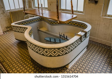 Hot Springs, AR / USA - 11-21-2014: Hubbard Tub with wooden patient lift on exhibit at Fordyce Bathhouse in Hot Springs National Park.