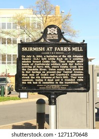 Hot Springs, AR/USA: March 30, 2018 – Historic marker notes site of Skirmish at Farr's Mill. Confederate soldiers attacked a battalion of Arkansas cavalry on July 5, 1864 during the Civil War.
