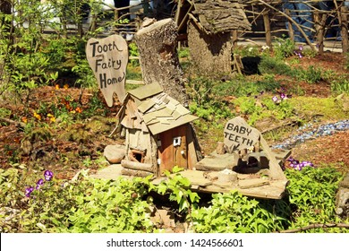 Hot Springs, AR/USA: March 31, 2018 – Tooth Fairy home village surrounded by spring plants and nature in the Garvan Woodland Gardens in Hot Springs, Arkansas.