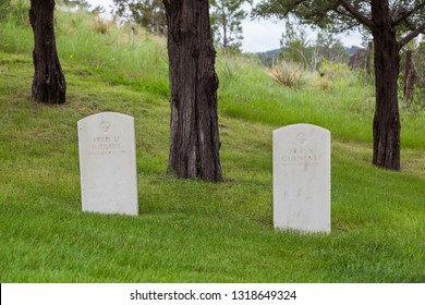 HOT SPRINGS, SOUTH DAKOTA - June 8, 2014:  Two graves off to the side with the same death date and no record of military service at Hot Springs National Cemetery in Hot Springs, SD on June 8, 2014.