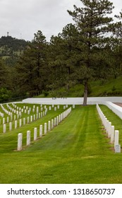 HOT SPRINGS, SOUTH DAKOTA - June 8, 2014:  Rows of soldiers white headstones on the hilly slope of Hot Springs National Cemetery in Hot Springs, SD on June 8, 2014.
