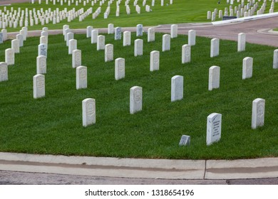 HOT SPRINGS, SOUTH DAKOTA - June 8, 2014:  A newer marble grave marker among older headstones for war veterans in section 8 of the Hot Springs National Cemetery in Hot Springs, SD on June 8, 2014.