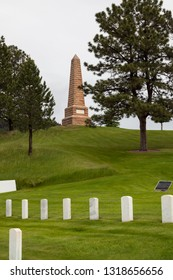 HOT SPRINGS, SOUTH DAKOTA - June 8, 2014:  A stone obelisk monument sits at the top of the hill above the graves in Hot Springs National Cemetery in Hot Springs, SD on June 8, 2014.