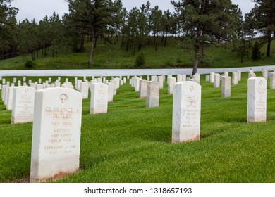 HOT SPRINGS, SOUTH DAKOTA - June 8, 2014:  A white marble headstone for a World War One soldier with rows of graves behind it at Hot Springs National Cemetery in Hot Springs, SD on June 8, 2014.