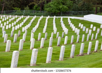 HOT SPRINGS, SOUTH DAKOTA - June 8, 2014:  Rows of marble headstones surrounded by green grass in a section for Civil War Soldiers of the National Cemetery in Hot Springs, SD on June 8, 2014.