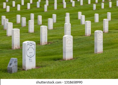 HOT SPRINGS, SOUTH DAKOTA - June 8, 2014:  A newer marble grave marker among older headstones for Civil War Soldiers in section 5 of the National Cemetery in Hot Springs, SD on June 8, 2014.