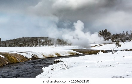 Hot steam and mist rise from geo-thermal pool in Yellowstone